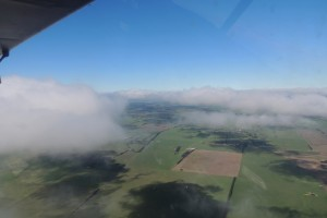 Cloud shadows on farmland below from 4800 ft