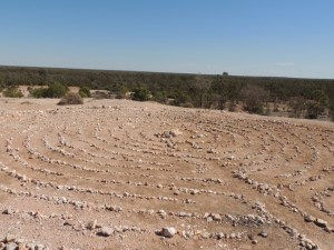 Rock maze at the site of the earliest opal diggings - a bit fragile, but the climate doesn' class=
