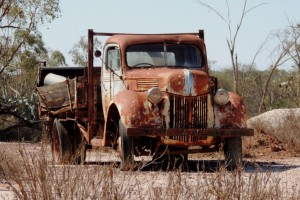 Many old trucks and utes are scattered around the opal fields