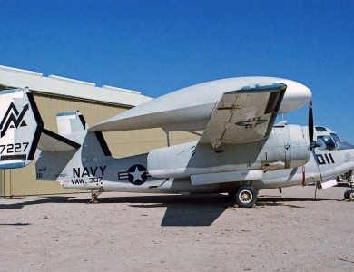 This exotic configuration is  Grumman E-1B Tracer 147227, an airborne early warning adaptation of the Grumman Tracker.